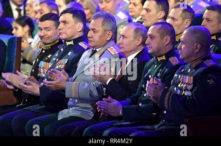 Moscow, Russia. 22nd Feb, 2019. Russian President Vladimir Putin, center, sits with Defence Minister Sergei Shoigu, left, and military leaders during a gala marking Defender of the Fatherland Day at the State Kremlin Palace February 22, 2019 in Moscow, Russia. Credit: Planetpix/Alamy Live News - Stock Image