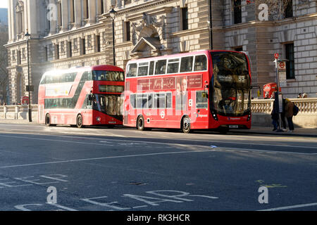 London busses at bus stop, London, United Kingdom. - Stock Image