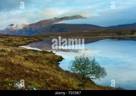 The Beinn Damh range over Loch an Lòin, Wester Ross, Highland Region, Scotland, UK - Stock Image