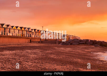 Beach huts at Southwold, Suffolk, England, at sunrise. - Stock Image