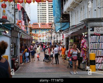 Shoppers in busy shopping street in the Chinese ethnic district China town of the city state Singapore popular with locals and tourists. - Stock Image