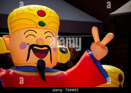 Decorative inflatable Chinese man for sale on the run up to Chinese New Year. - Stock Image