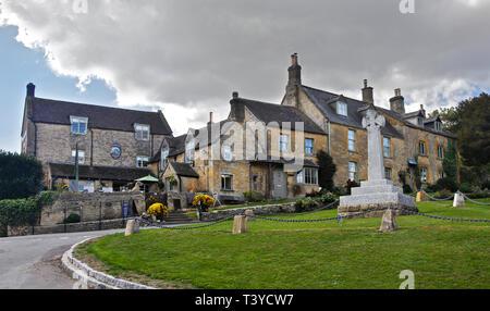Coach and Horses Pub and War Memorial, Longborough, Gloucestershire, England - Stock Image