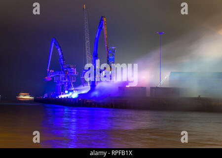 Poole, UK. 21st Feb, 2019. Poole, Dorset. 21st February 2019. Hundreds of visitors head to Poole Quay and town centre to see the light and art installations as part of the 'Light Up Poole' arts festival. HARBOUR GLOW by James Smith, Audacious and Wolf Lighting Credit: Thomas Faull/Alamy Live News - Stock Image