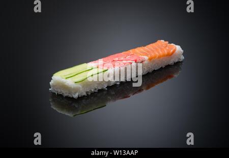 sushi on black background with reflection - Stock Image