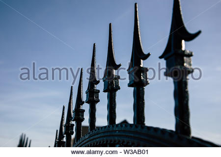 Closeup of black metal fence spikes perspective - Stock Image
