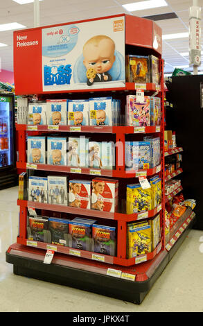 Boss Baby and other movies (DVDs) being sold at a point-of-purchase display near the check out register at a Target store - Stock Image