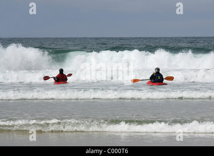 Kayaking the Surf at Perranporth Beach, North Cornwall Coast, Britain, UK. - Stock Image