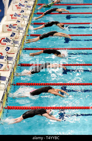 Swimmers in heat 7 enter the water in the Women's 200m Backstroke during day four of the 2019 British Swimming Championships at Tollcross International Swimming Centre, Glasgow. - Stock Image
