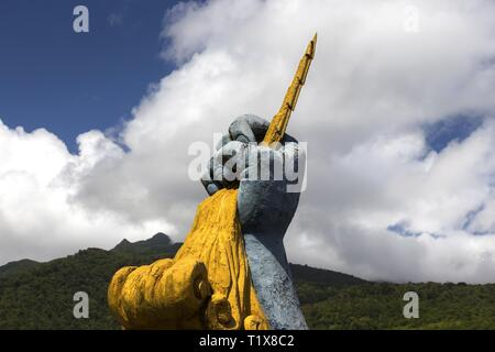 Human Fist Holding Lightning Sculpture Symbol of Harvesting Power of Nature Mirador De Fortuna Viewpoint near Hydro Power Plant in Panama - Stock Image