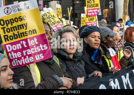 London, UK. 9th Dec, 2018. Women including Lousie Raw and Claudia Webb hold the main banner at the start of the united counter demonstration by anti-fascists in opposition to Tommy Robinson's fascist pro-Brexit march. The march which included both remain and leave supporting anti-fascists gathered at the BBC to to to a rally at Downing St. Police had issued conditions on both events designed to keep the two groups well apart. Credit: Peter Marshall/Alamy Live News - Stock Image