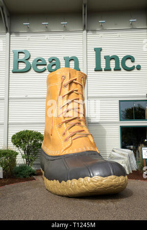 Giant bean boot commemorating L.L. Bean's 90th anniversary, displayed outside the company's flagship store in Freeport, Maine, USA. - Stock Image