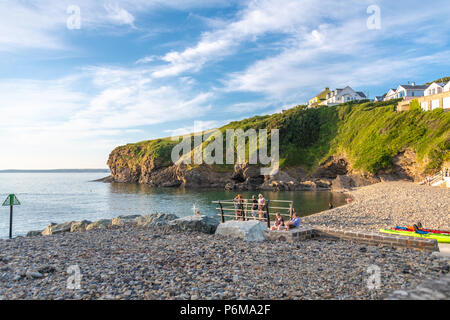 Broad Haven, Wales, UK. 30th June 2018. People enjoy the last of the June heatwave on the beach at Little Haven in South Wales. Credit Thomas Faull / Alamy Live News - Stock Image