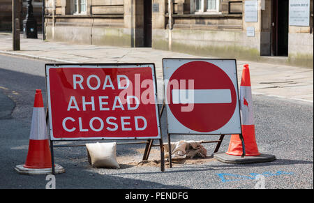 Traffic cones and signs indicating no entry and a road closed for roadworks Preston Lancashire June 2018 - Stock Image