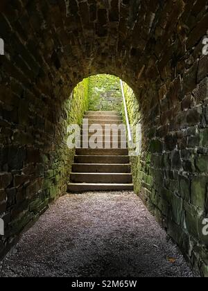 Tunnel leading to garden staircase. - Stock Image