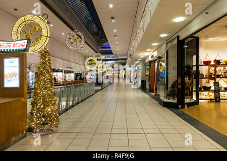 A section of Buchan Galleries shopping mall in the centre of Glasgow, Scotland, decorated for Christmas. Kristy Kreme, gold Christmas tree, John Lewis - Stock Image