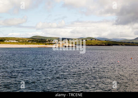 Panoramic view of the shore with Ballingskellings Abbey and Kerry Mountains in the Background.Ballingskelligs Bay in County Kerry,Ireland. - Stock Image