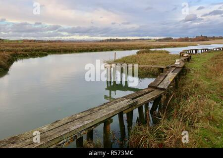 Dangerous! A rickety bridge / jetty beside the River Deben, Waldringfield, Suffolk, UK. Winter - November 2018. - Stock Image