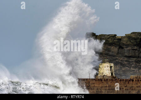 Portreath, Cornwall, UK. 3rd March, 2019.  Storm Freya swept into the Cornish coast and produced towering waves that threatened to damage the  historic Monkey Hut on the pier at Portreath.  Gordon Scammell/Alamy Live News. - Stock Image