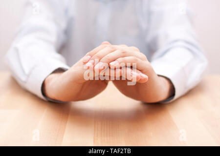 Hands in gesture of protection. Concept of insurance, safety - Stock Image