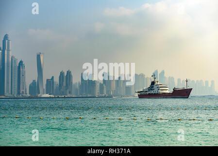 Ship on sea, skyline on background - Stock Image