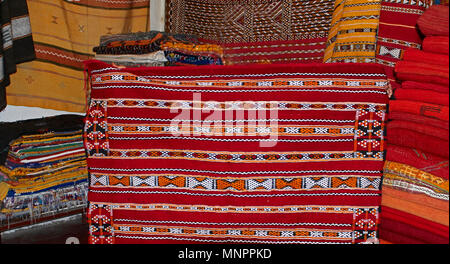 A display of colourful traditioal decorated carpet In the Souk the Street Market at Jemaa el Fnaa in the Medina Old City in the centre of Marrakech in - Stock Image