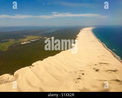 Flying out of Newcastle with beach land and sea in New South Wales Australia - Stock Image