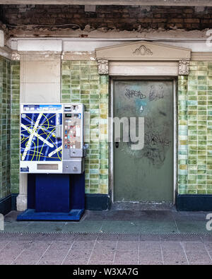 Berlin-Lichterfelde Ost railway station interior passage with decorative door and green tiled wall. Historic listed building - Stock Image