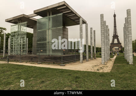France, Paris, The Wall For Peace, Located on the Champ-de-Mars for the commemorations of the year 2000, The structure consists of 12 glass panels. - Stock Image