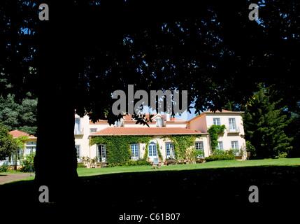 The rear exterior of the Casa Velha do Palheiro five-star country house hotel in Madeira, Portugal. - Stock Image