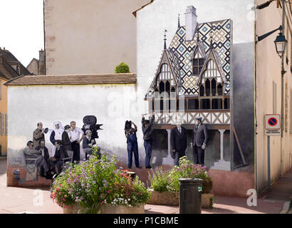 Trompe l'oeil Painted wall illustrating the making of a film at the 'Hotel Dieu' Beaune Burgundy France - Stock Image