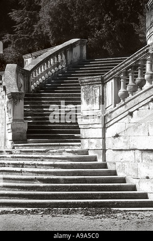 Curving stone staircase in Jardins de la Fontaine Nimes France. Mono image. - Stock Image