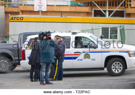 Cameraman and RCMP security on hand to welcome Canadian Prime Minister Justin Trudeau for his talk to the media about affordable housing. Maple Ridge. - Stock Image