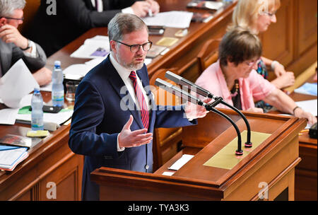 Prague, Czech Republic. 26th June, 2019. Czech MP Petr Fiala speaks during the Chamber of Deputies meeting to hold no-confidence vote in Babis's government, triggered by five opposition parties, in Prague, Czech Republic, on June 26, 2019. Credit: Vit Simanek/CTK Photo/Alamy Live News - Stock Image