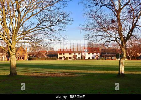 Bright winter morning at the village green. Martlesham Heath, Suffolk, UK, December 2018. - Stock Image