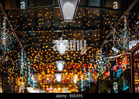 Christmas light bokeh in the Covent Garden Market in London, UK - Stock Image