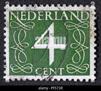 Used franked Nederland Netherlands Stamp, Green 4c Four Cent - Stock Image