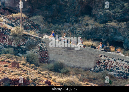 Tourists on Donkeys Santorini Caldera Greece - Stock Image