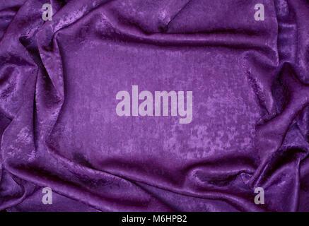 background drape fabric  violet close-up - Stock Image