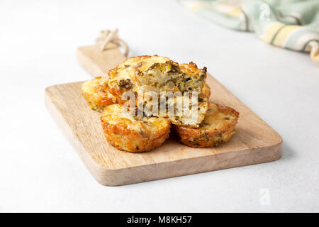 healthy breakfast. broccoli cheese bites (muffins) on light concrete background - Stock Image