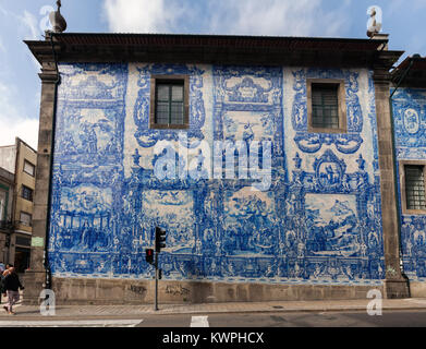 Porto, Portugal, August 14, 2017: Exterior walls of the Porto's Chapel of Souls are virtually entirely covered - Stock Image