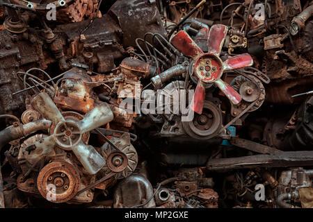 Rusty engine blocks on a street in Bangkok, Thailand - Stock Image