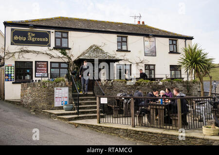 The Ship Aground village pub with people dining outside in Mortehoe, North Devon, England, UK, Britain - Stock Image