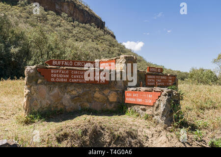 Stone road sign with directions, Hells Gate National Park, Kenya - Stock Image