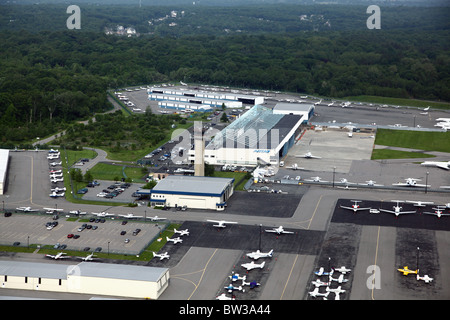 Aerial view of hangars, tarmac and control tower at Westchester County Airport, Harrison, NY, USA - Stock Image