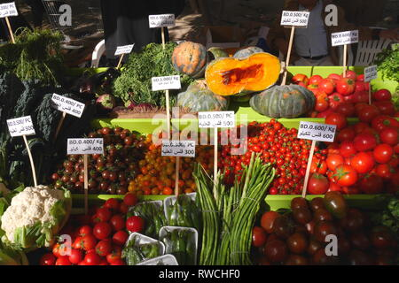 Fruit and vegetables for sale on a stall at the farmers market, botanical garden, Budaiya, Kingdom of Bahrain - Stock Image