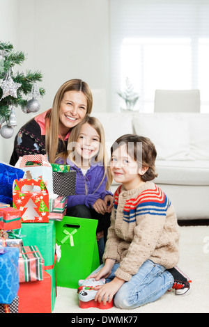 Mother And Children With Christmas Gifts - Stock Image