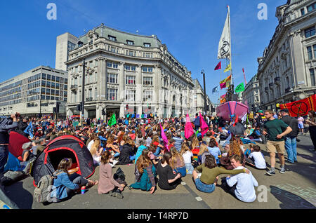 London, UK. 19th Apr 2019. Environmental campaign group Extinction Rebellion continue to stop occupy several locations around the city, to demand that the Government take emergency action on the climate and ecological crisis. Oxford Circus Credit: PjrFoto/Alamy Live News - Stock Image
