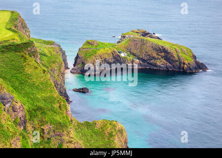 aerial view of the Carrick-a-Rede Rope Bridge and Carrickarede island, UK - Stock Image