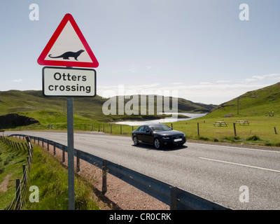 'Otters crossing' warning road sign at Mavis Grind, Shetland Islands. June 2010. - Stock Image